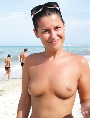Young nudists rub oil on each other's naked bodies