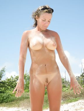 Gorgeous wet young nudist plays in the water