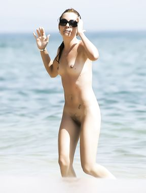 Busty chick shows her naked body at the nude beach