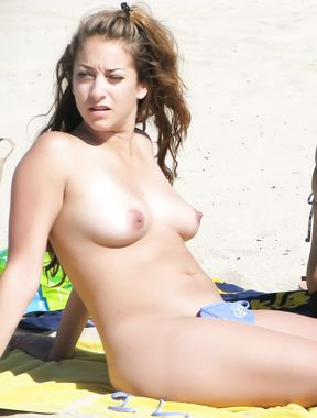 Topless Teen On European Beach