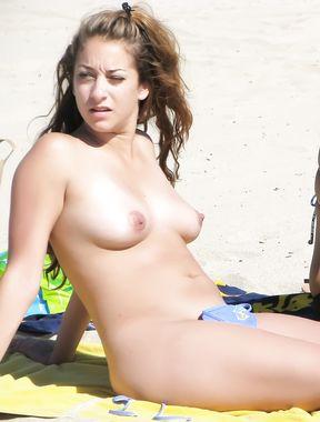 Topless Teen On European Beach