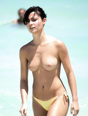 Topless Girls Walking On The Beach