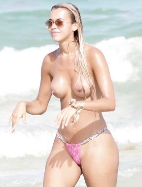 girl topless on beach in australia